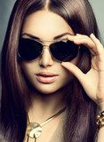 Beauty model girl with long brown hair wearing sunglasses