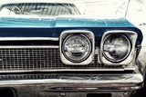 Close Up of Front of a Blue Vintage Car